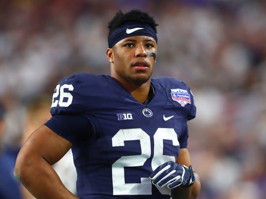 Penn State Nittany Lions running back Saquon Barkley (26) against the Washington Huskies in the 2017 Fiesta Bowl at University of Phoenix Stadium.