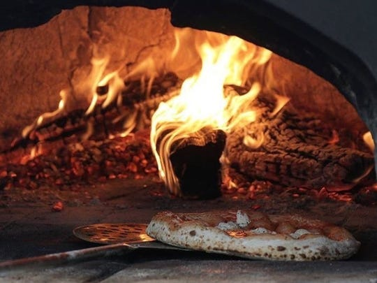 Coney Island Pizza uses a wood-burning brick oven to make its pizzas