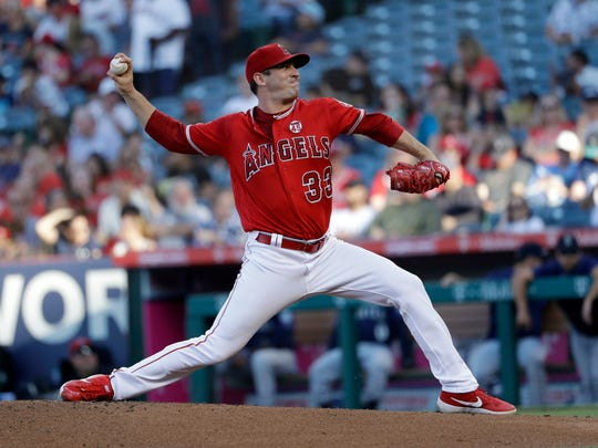 Los Angeles Angels starting pitcher Matt Harvey throws to a Seattle Mariners batter during the second inning of a baseball game Saturday, July 13, 2019, in Anaheim, Calif. (AP Photo/Marcio Jose Sanchez)