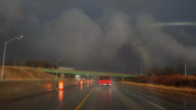 Traffic heads eastward into an intense storm that raked across the Des Moines metro on Wednesday, Nov. 11, 2015, The storm caused numerous damages, included damage to the roof of the Wal-Mart in Knoxville,