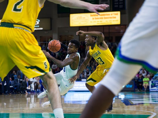 Florida Gulf Coast University junior, Brandon Goodwin, turns into his defender, Siena College freshman, Khalil Richard, and falls to the ground during the game against Siena College on Friday, December 9, 2016 at Alico Arena in Estero, Fla.