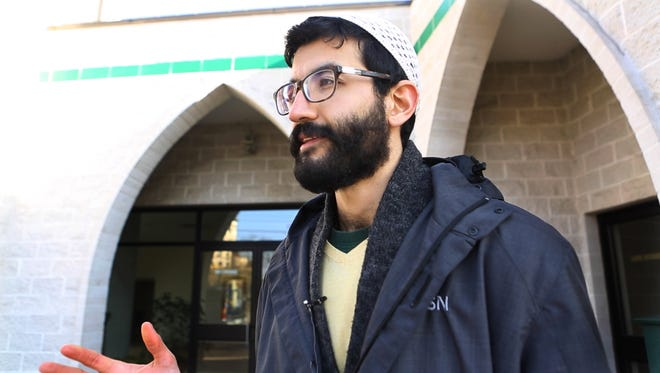 Al-Sharif Nassef, 23, of Indian Hill explains Friday that Islam stands for peace, not violence.