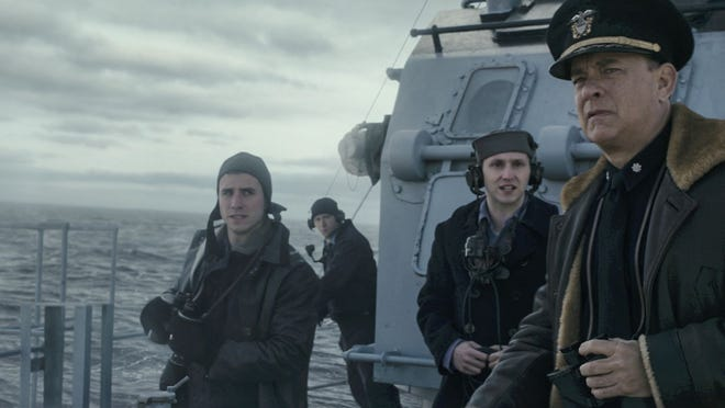 """Captain Krause (Tom Hanks) with crew on the lookout for German U-Boats in """"Greyhound."""""""