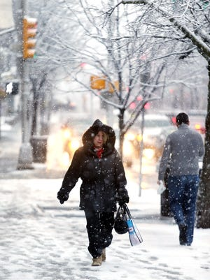Gwen O'Connor of Rockaway walks down W. Park Place in Morristown as Morris County woke up to snow Friday morning, the  National Weather Service issuing a Winter Weather Advisory for 1 to 3 inches of snow . February 5, 2016, Morristown, NJ.