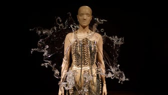 """A dress from the Crystillization collection in the new """"Iris van Herpen: Transforming Fashion"""" temporary installation at the Cincinnati Art Museum in the Mt. Adams neighborhood of Cincinnati on Thursday, Nov. 2, 2017. Transforming Fashion is open now through Jan. 7, before moving to Phoenix."""