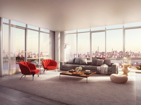 The living room features impressive views, which can be enjoyed through floor-to-ceiling windows.