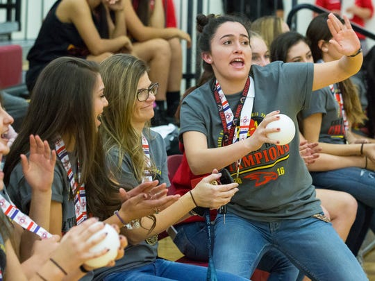 Centennial High School volleyball player, Raquel Gonzales, 17, who plays setter, dances on December 2, 2016, during a pep ralley in honor of the volleyball team winning the state championship.