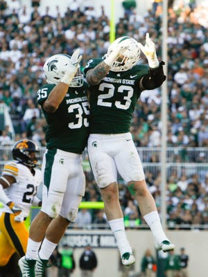 MSU's Joe Bachie and Chris Frey, 23, celebrate an MSU touchdown against Iowa Saturday, Sept. 30, 2017, at Spartan Stadium in East Lansing.