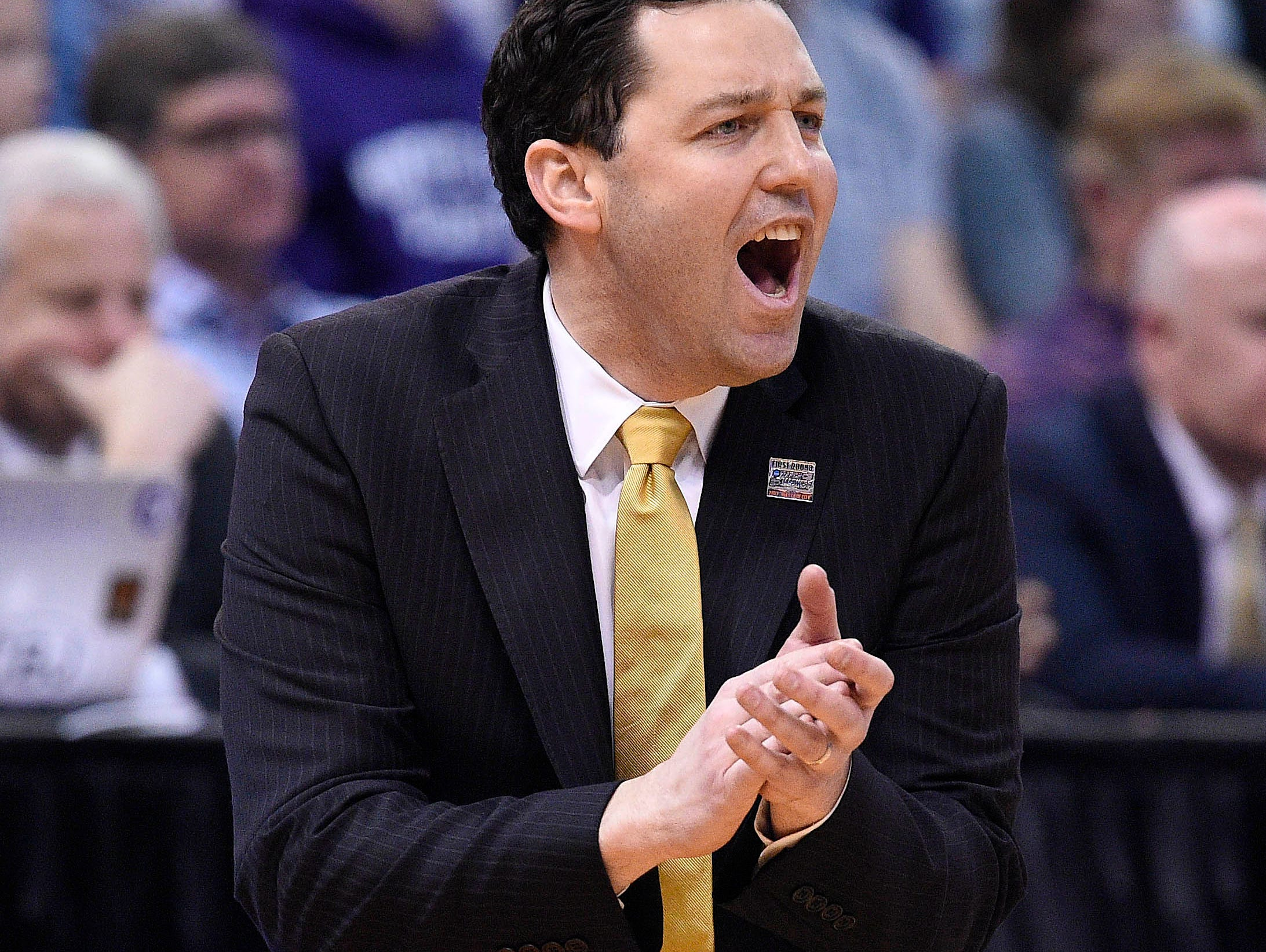 Vanderbilt coach Bryce Drew watches game action against Northwestern during the first half of the NCAA Tournament first-round game in Salt Lake City on March 16, 2017.