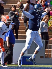 Rice quarterback Jackson Tyner, right, celebrates his