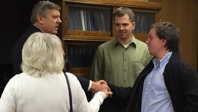 Ed Olson, far left, at his retirement reception.
