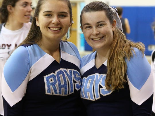 MIA Varsity Cheerleaders Jayce Dawson and Natalie Hughes.