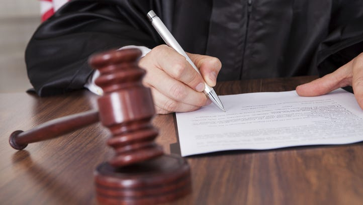 File photo, Judge writng on paper