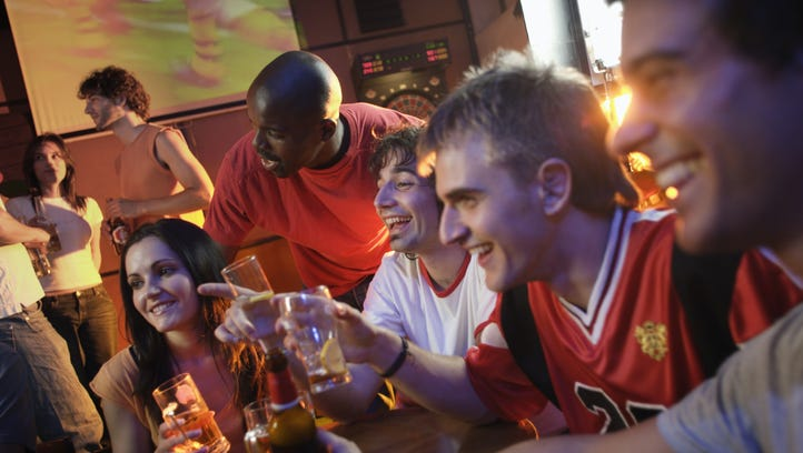 Soccer Fans and Young Adults in Bar