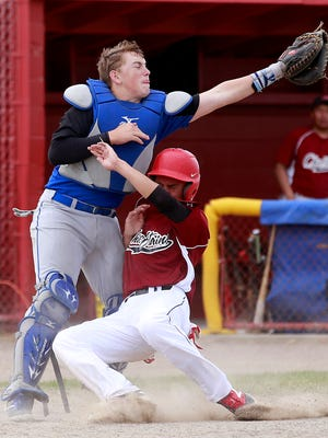 Shiprock's Julian Aspaas collides with Bloomfield catcher Luke Deifenbaugh during their game on April 14 at Shiprock High School.