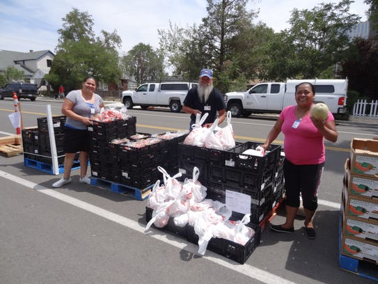 Volunteers assist with the Food Bank's mobile pantry.