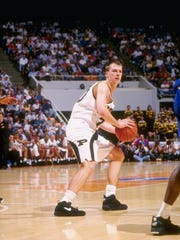 Purdue's Linc Darner looks to pass during a March 1994 game against Kansas. The new UWGB coach is a former guard for the Boilermakers.