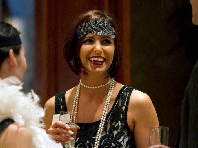 "Maytee Gomez talks with friends during the President's Club annual fundraiser hosted by the Bonita Springs Area Chamber of Commerce Friday evening at Quail West Golf and Country Club in Naples. The event featured the theme of  ""The Great Gatsby"" with a live and silent auction and wine raffles."