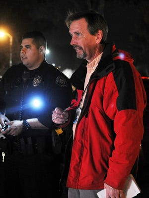 Chris Rivera, left, Santa Paula police officer, chats with The Star reporter Tom Kisken during a Friday night ridealong.