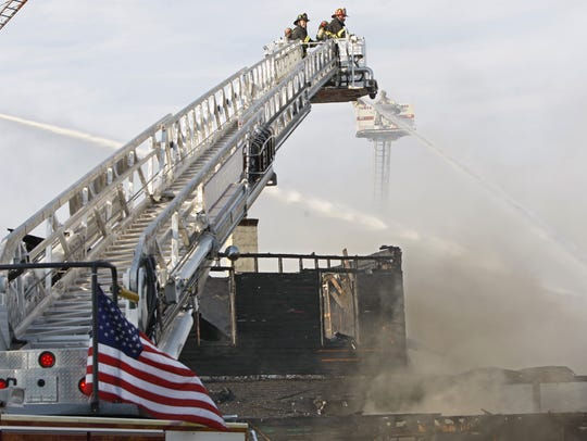 Archive: East Rochester firefighters battle a building fire.