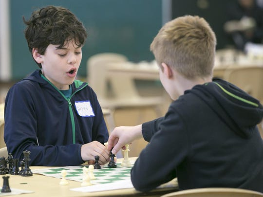 """Aiden Kelly, 11, of Madison, reacts as his opponent Elliot Marken, 11 of East Hanover, captures his queen. The Knights of Columbus host their annual """"Chess 'Round-Robin' Tournament Anyone?"""" for grades 3-8, at Holy Family Roman Catholic Church, Florham Park, NJ. Sat., April 1, 2017. Special to NJ Press Media/Karen Mancinelli/Daily Record MOR 0402 K of C Chess Tournament"""