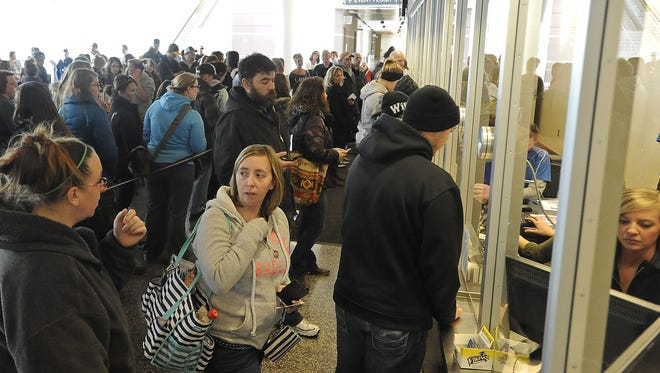Fans stand in line for Luke Bryan tickets at Denny Sanford Premier Center in Sioux Falls, S.D., Friday, Jan. 23, 2015.