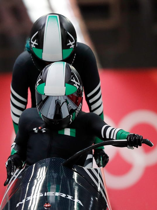 Driver Seun Adigun and Akuoma Omeoga of Nigeria start their first heat during the women's two-man bobsled competition at the 2018 Winter Olympics in Pyeongchang, South Korea, Tuesday, Feb. 20, 2018. (AP Photo/Andy Wong)