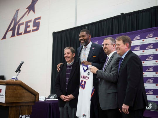 University of Evansville President Thomas Kazee, from left, new mens basketball head coach Walter McCarty, Athletic Director Mark Spencer and Senior Associate Athletic Director Lance Wilkerson pose for a photo introducing McCarty at Meeks Family Fieldhouse on Friday, March 23, 2018. McCarty, an Evansville native was announced as the new University of Evansville mens basketball coach Thursday.