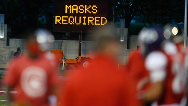 A sign reminds patrons that masks are required for the Shrine Bowl in July at Hummer Sports Park. Topeka Unified School District 501's football teams may continue practicing for two weeks after the Topeka Board of Education voted to postpone a decision on competitive play until Sept. 17.