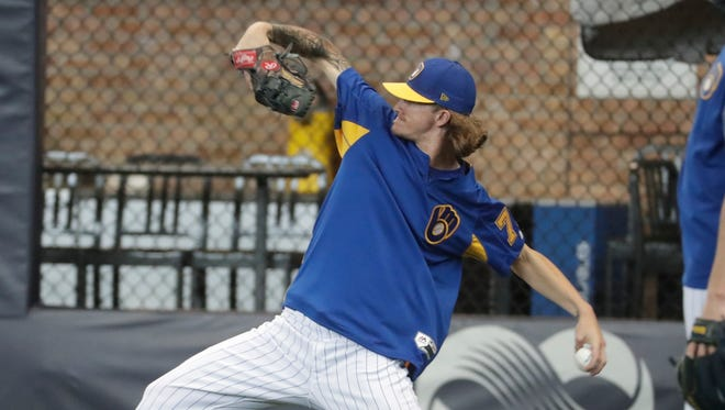 Brewers relief pitcher Josh Hader warms up before Friday's game against the Dodgers.