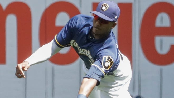 Centerfielder Lewis Brinson was a key piece of the Brewers' future the A's would have wanted in a deal for pitcher Sonny Gray.