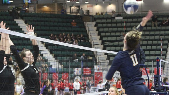 Panas volleyball hitter Jenn Braun attacks a ball against Kings Park in the Class A NYSPHSAA volleyball championships at the Cool Insuring Arena in Glens Falls.