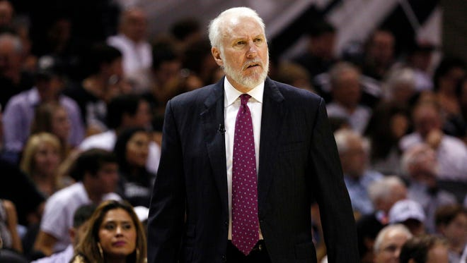 San Antonio Spurs head coach Gregg Popovich reacts against the Dallas Mavericks during the first half at AT&T Center on Oct. 28, 2014.