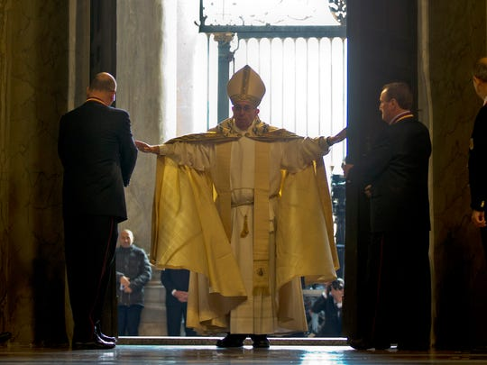 Pope Francis enters St. Peter's Basilica after pushing
