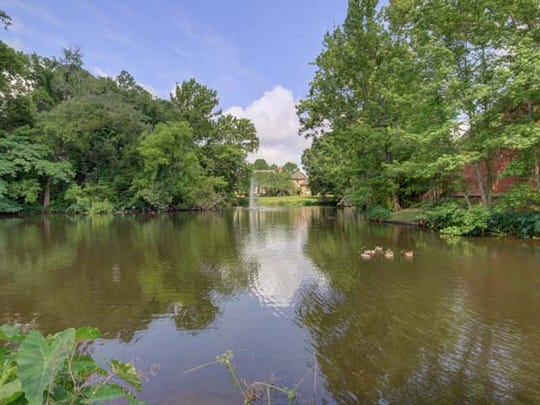 This mansion is across from the Vermilion River and has its own pond out front.