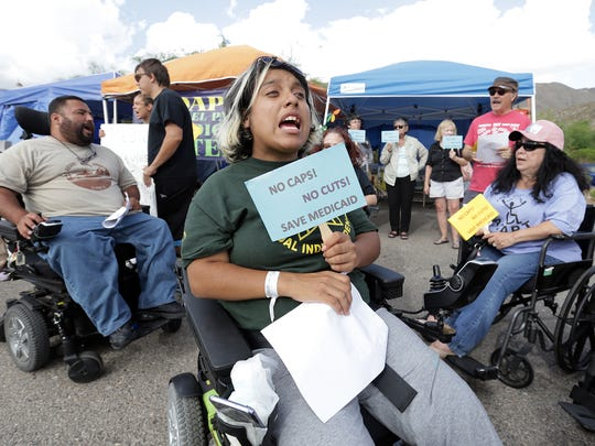 Lucero Torres chants along with other members of El Paso Desert Adapt on Thursday before the group packed up its protest site outside of GOP headquarters in El Paso.