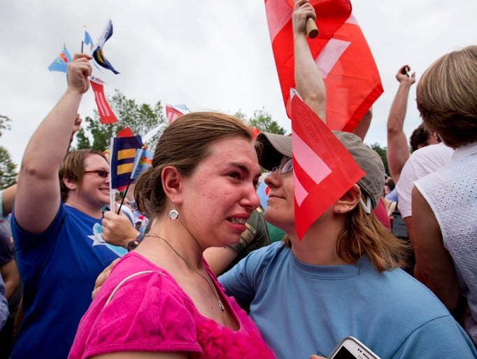 Ariel Olah of Detroit, left, and her fiancee Katie