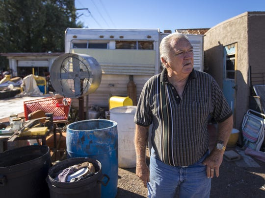 Steve Sussex strolls through a dirt lot, on Oct. 13, 2014, that appears like a 2-acre junkyard filled with a couple of hand-made buildings weathered by time, a bus, a cab of a semi-truck, assorted pieces and parts, lumber and bricks. But it is part of his Tempe birthright, he says. Tucked away in the lot is an adobe home, on the corner of Farmer Avenue and 1st Street, that his great-grandfather built in the late 1800s, one the city deems historic.