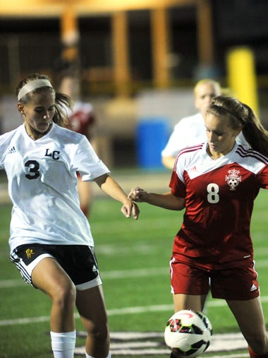 Rosecrans' Darby Lynch (right) fights for possession