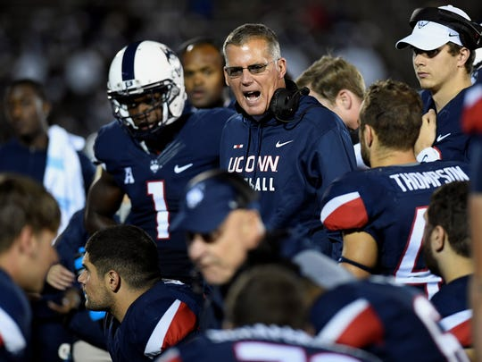 Connecticut head coach Randy Edsall is seen here in a file photo talking to the Huskies football team. The UConn football program may soon be looking for a new conference home. Edsall is a Susquehannock High School graduate.