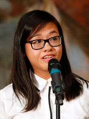 Linh Ta speaks at a Des Moines Storytellers event at Hoyt Sherman Place Wednesday, Aug. 16, 2017.