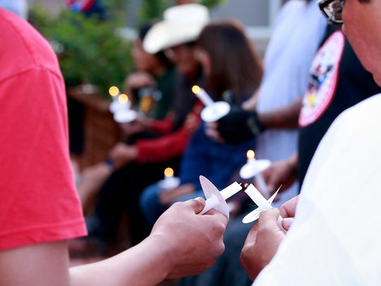 Participants in Healing Begins-Never Lose Hope light candles in memory of loved ones lost to violence on Wednesday at the Northern Navajo Medical Center in Shiprock.