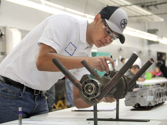 Caleb Barrientos, a freshman at Hereford High School in Hereford, Texas, competes in San Juan College's annual SkillsUSA invitational on Friday at the school's auto technician shop in Farmington.