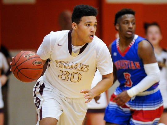 Webster County's Malachi Powell (30) drives past Christian
