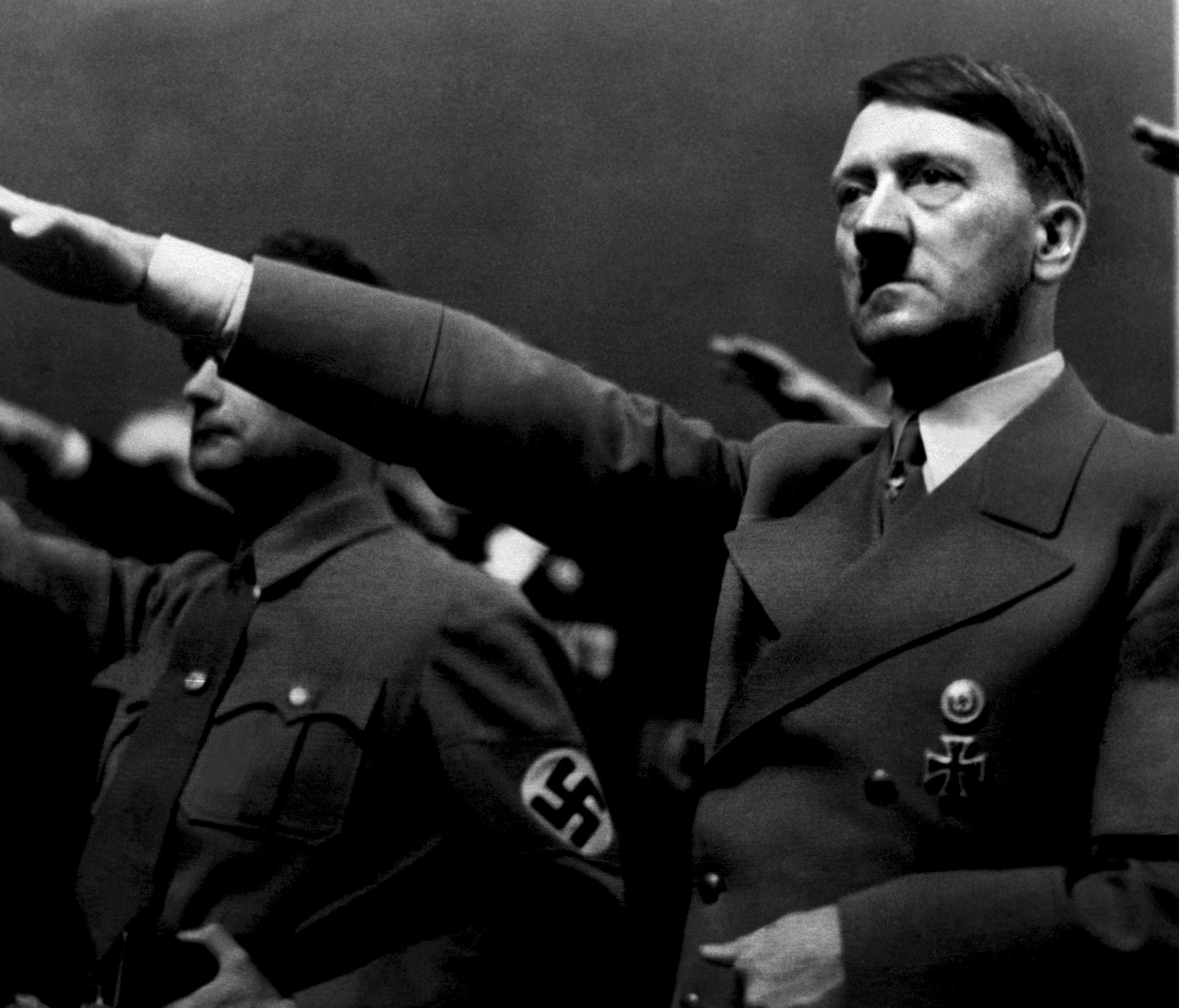 A picture dated 1939 shows German Nazi Chancellor Adolf Hitler giving the nazi salute during a rally next to