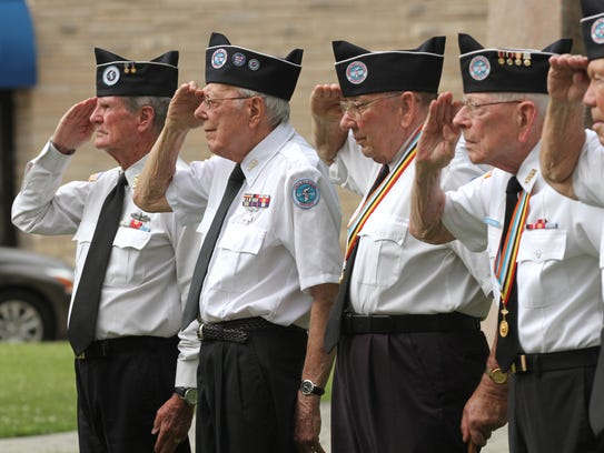 Members of the Korean War Veterans Association salute