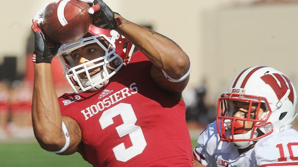 Cody Latimer of IU pulls in a pass for an IU gain in the first half. Indiana lost to Wisconsin 62-14 in Big Ten football Saturday November 10, 2012 at Memorial Stadium in Bloomington.