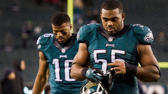 Eagles linebacker Brandon Graham (No. 55) and wide receiver Brad Smith (No. 16) walk off the field following the Eagles 38-27 loss to the Cowboys at Lincoln Financial Field in Philadelphia on Sunday night.
