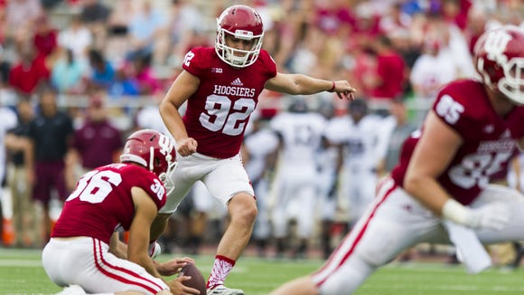 Indiana Hoosiers place kicker Griffin Oakes (92) kicks an extra point after a touch down during second-half action of a NCAA football game, Saturday, September 5, 2015, in Bloomington. Indiana won the game 48-47.