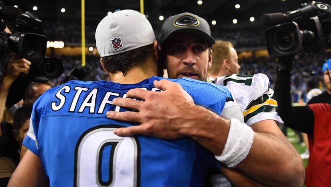 Dec 3, 2015; Detroit, MI, USA; Green Bay Packers quarterback Aaron Rodgers (12) and Detroit Lions quarterback Matthew Stafford (9) after the game at Ford Field. Green Bay won 27-23. Mandatory Credit: Tim Fuller-USA TODAY Sports